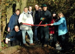 Volunteers open the new bridge in the wood