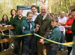 Cllr David Munro cuts the ribbon with local scouts